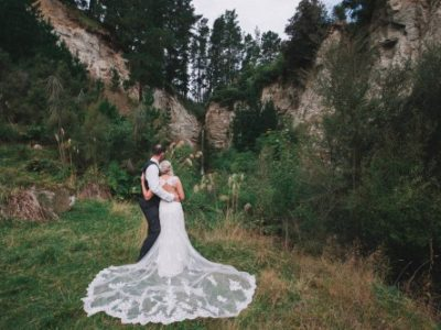 A bride and groom bridal wedding portrait by Binh Trinh at Makoura Lodge, a Manawatu wedding venue
