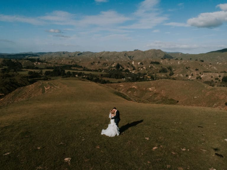 A couple kiss for a New Zealand farm wedding photography by Binh Trinh