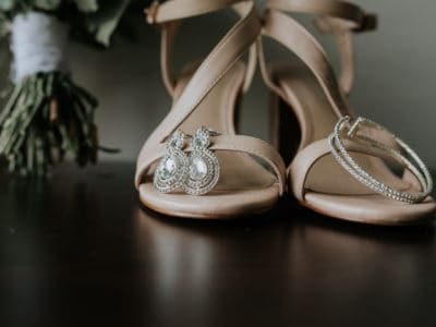 Wedding earing and wedding shoes detailed image at Wharerata wedding venue