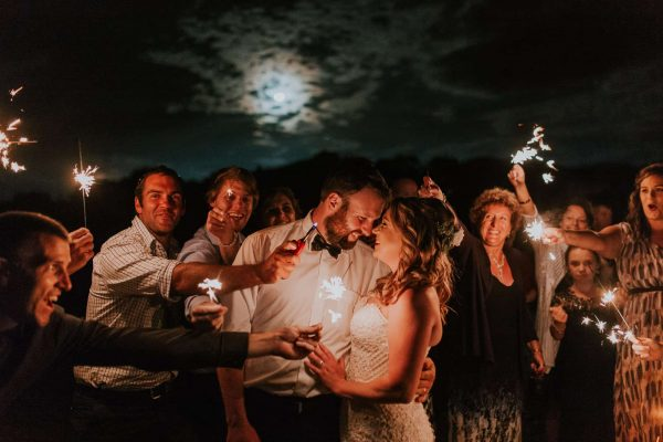 A creative bride and groom wedding photo with sparkles at a New Zealand farm wedding