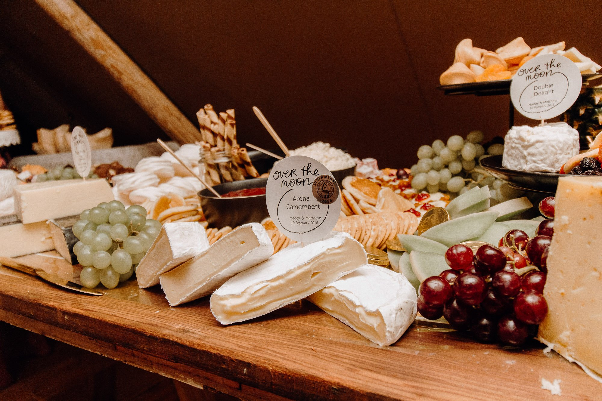 Wedding Photography Of Grazing Table Ideas 003, filled with cheese, crackers, fresh fruits and more cheese